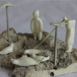 Inuit Carving of Seal Hunt by Emillie Illuitok in Ivory and Whale Bone