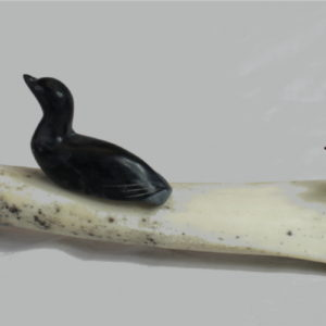 Inuit carving of five loons on bone base by Maurice Arnatsiak