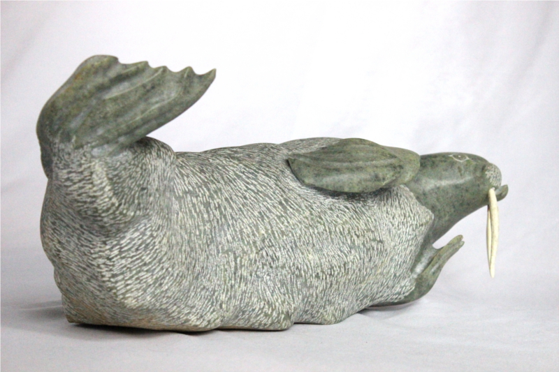 Inuit carving Of Walrus by Donnie Pitsiulak