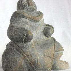 Inuit carving of woman by Thomas Akilak