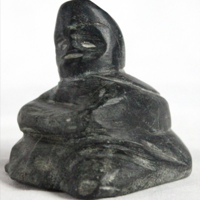 Inuit carving of resting woman by David Toolooktook