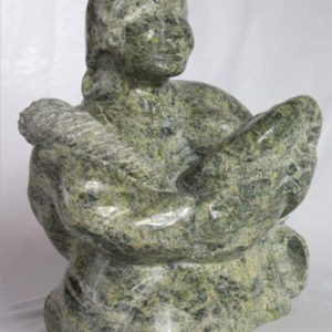 Inuit carving of woman breastfeeding by Elijah Michael