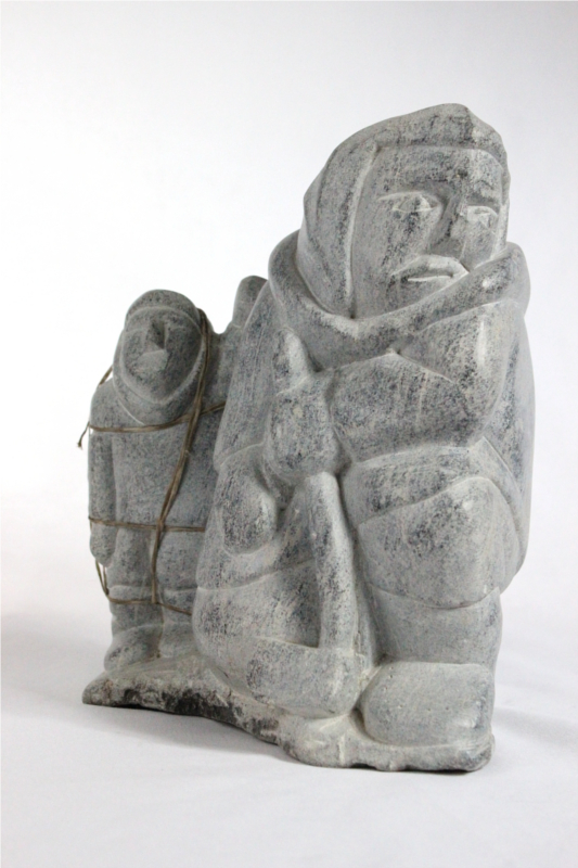 Inuit carving of giant and man by Aisa Amittuk