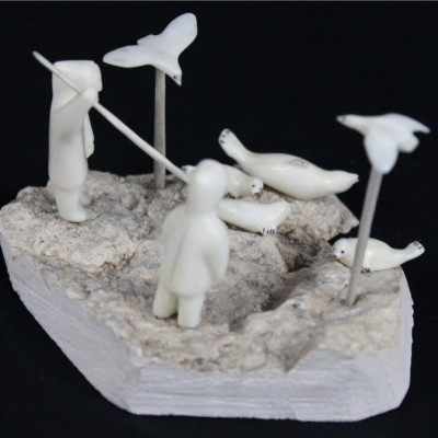 Inuit Carving of Seal Hunt by Emily Illutok