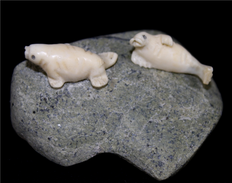 Inuit Carving of two Seals on Rock by Henry Nakoolak