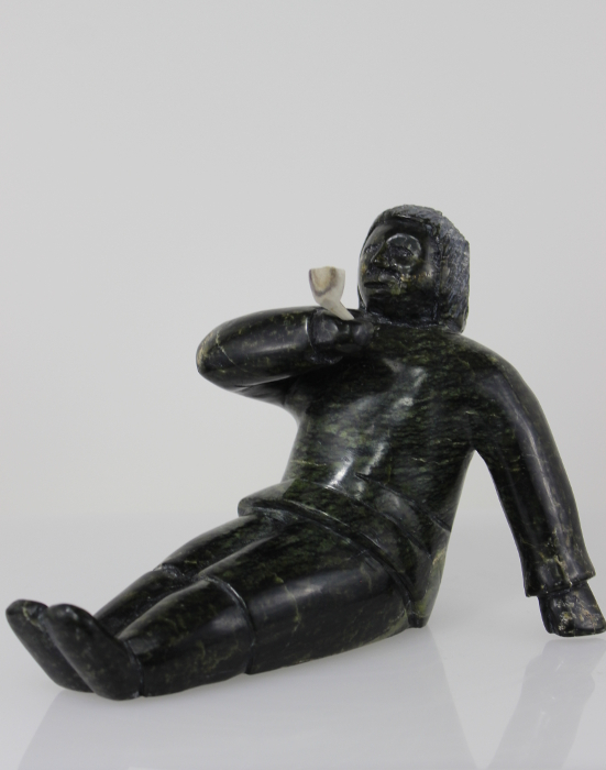 Man smoking pipe carved by Isaaci Etidloie