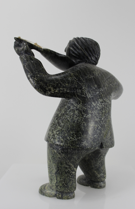 Fiddler carved by an Inuit artist from Cape Dorset