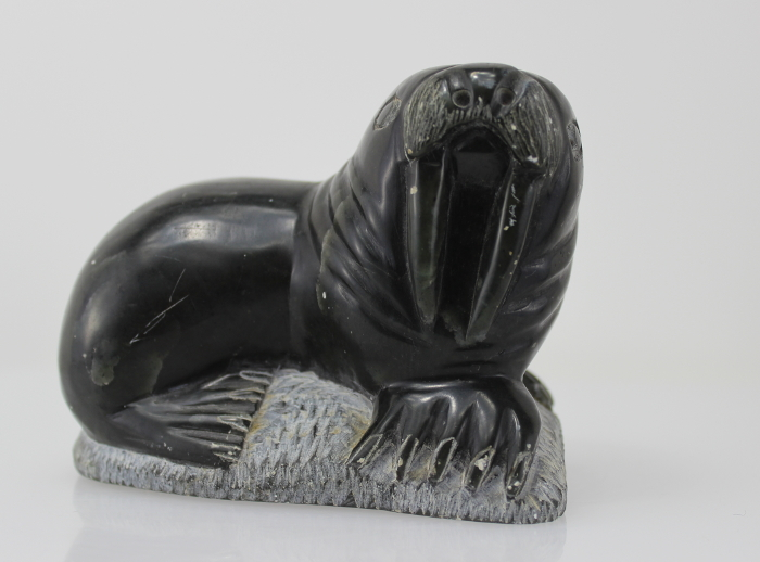 Carving of a walrus on a rock, by unknown Inuit Artist