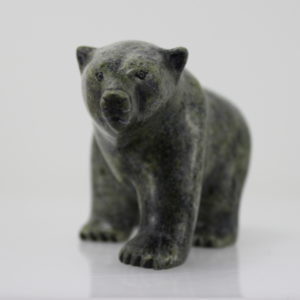 Serpentine polar bear carved by Qiliktee Qiliktee, an Inuit artist from Cape Dorset