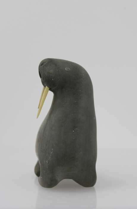 Great walrus with bird carved by an unknown Inuit artist