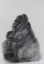 Stone carving of a hunter and seal by Aisa Amittuk, an Inuit artist from Akulivik