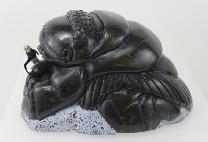 Gorgeous carving of an Inuit woman fishing by Adamie Inukpuk