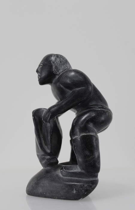 Wonderful carving of a man dressing by an unknown Inuit artist