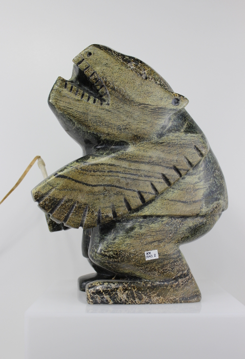 Striking carving called Shaman and Spirits by Palaya Qiatsuq, an Inuit artist from Cape Dorset