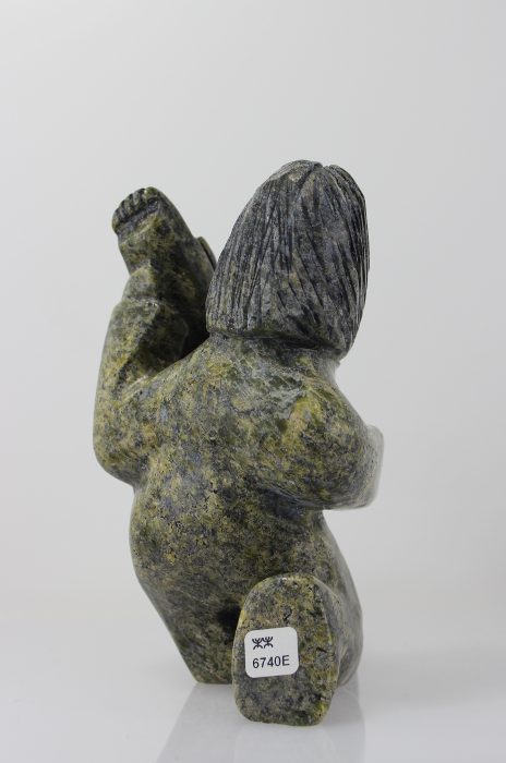 Charming carving by Noah Kelly, an Inuit artist from Cape Dorset.