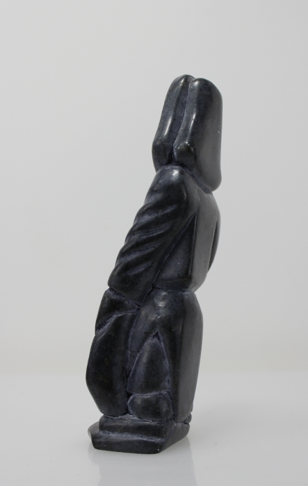 Man with seal, carved by Bobby Aupaluktuk, an Inuit artist from Inukjuak