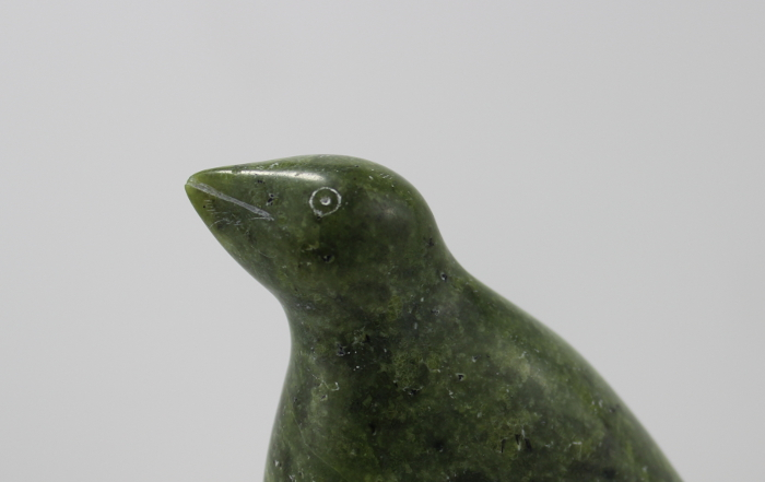 Stunning vibrant green stone carving by an unknown artist of a bird.