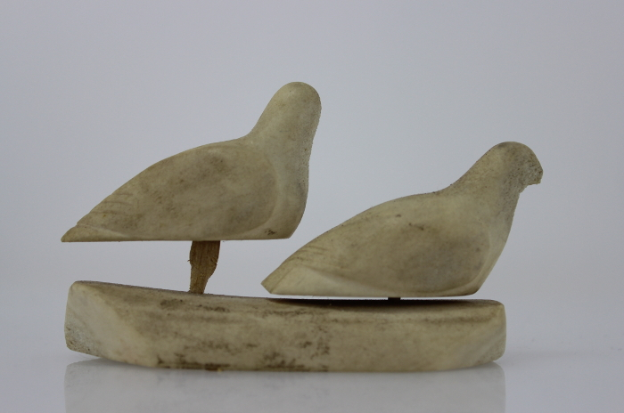 Two birds carved in bone by an unknown Inuit artist. This is a fantastic little carving.