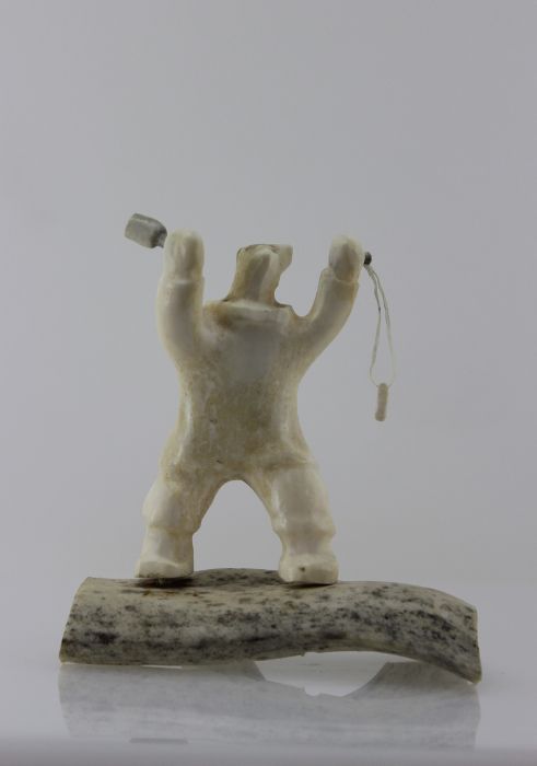 Shaman Bear by Louie Makkituq is a phenomenal carving in cream stone. A striking piece.