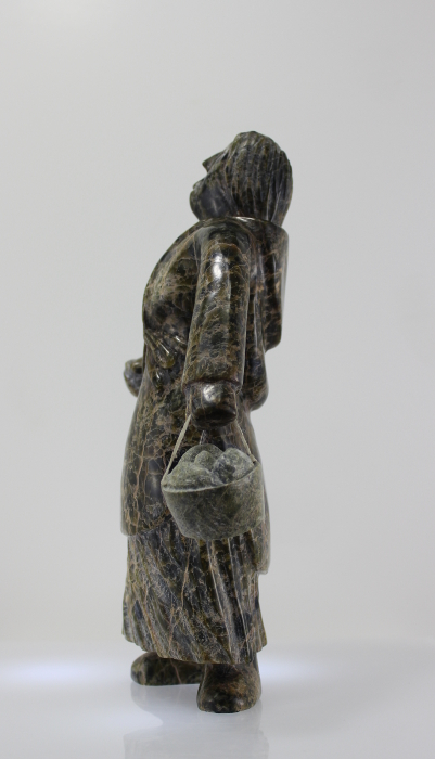 Wonderful carving of a woman with a pail of eggs, carved by Pitseolak Qimirpik