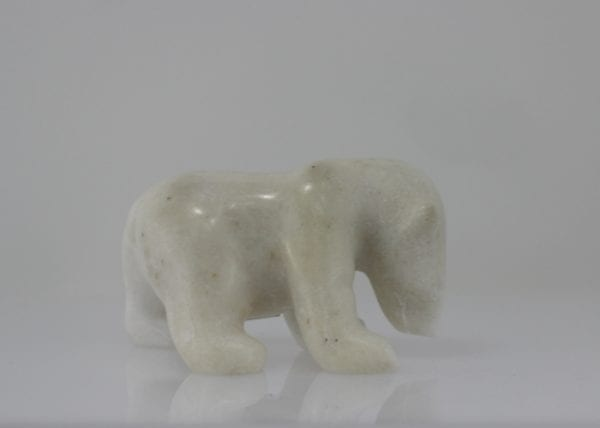 Beautifully carved polar bear made by Pauloosie Tunnillie, an Inuit artist from Cape Dorset.
