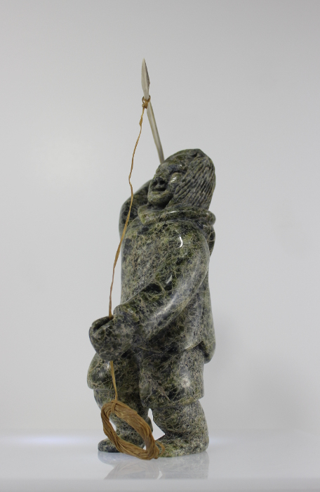 Charismatic hunter carved by Napachie Ashoona, an Inuit artist from Cape Dorset