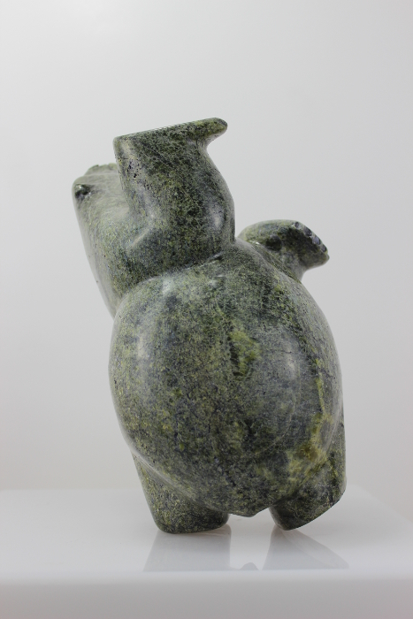 Stunning dancing bear carved by Inuit artist Isacie Petaullassie.