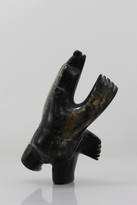 Gorgeous serpentine bear, dancing up a storm, carved by Abraham Simeonie, an Inuit artist from Cape Dorset.