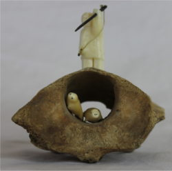 Inuit Carving of Man and Seals in Ivory and Whale Bone by Alina Tungilik