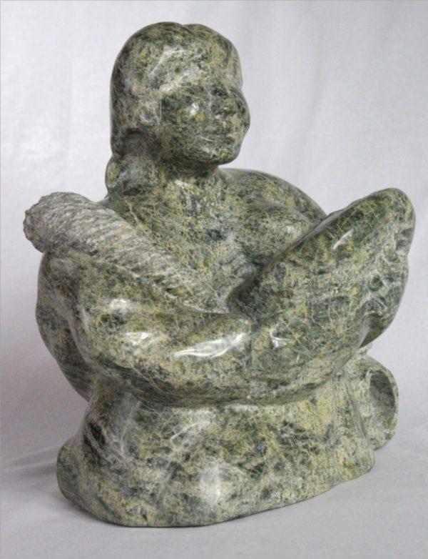 Inuit carving of woman breastfeeding by Elijah Michael