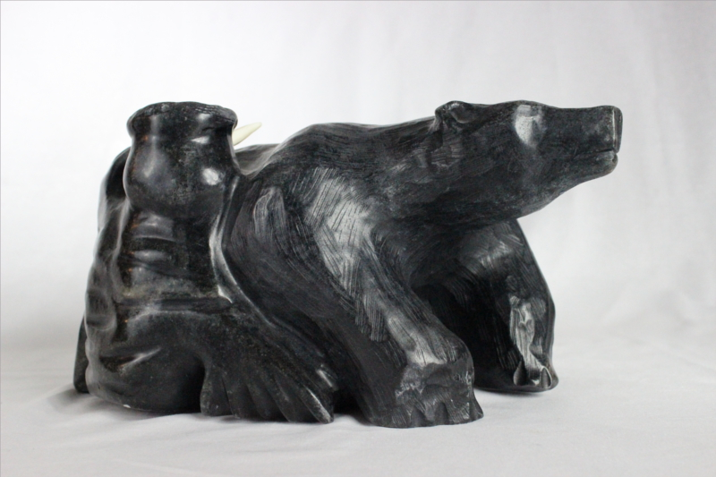 Inuit carving of walrus and bear by Mark Tertiluk
