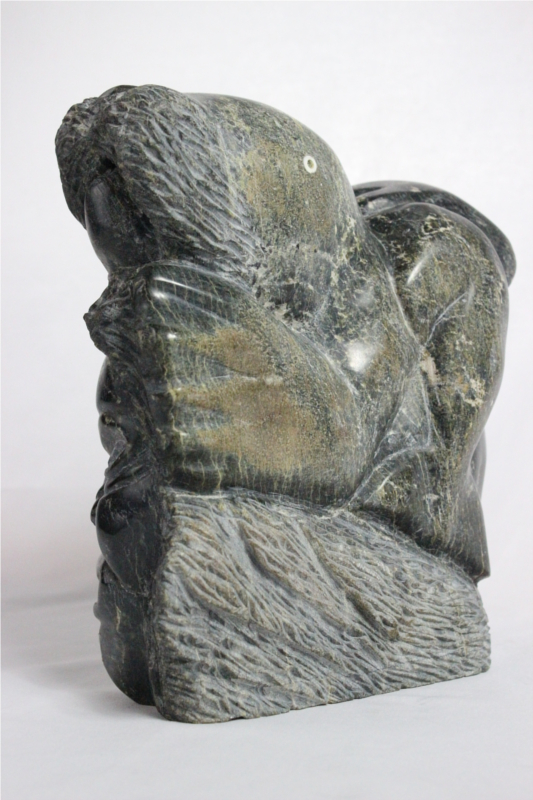 Inuit carving of composition by Mathew Ashevak