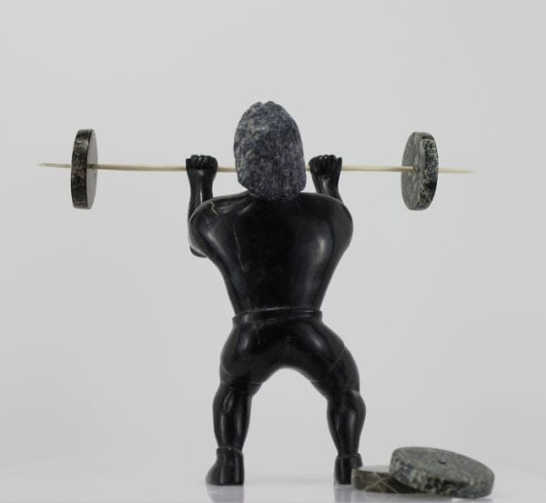 Weight Lifter Inuit carving by Isaaci Etidoie