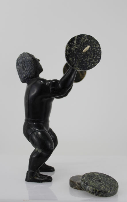 Weight Lifter Inuit carving by Isaaci Etidloie