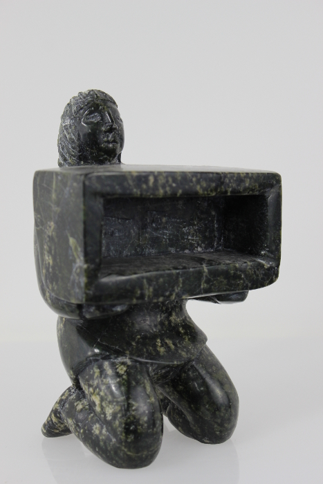 Man Holding Box by Isaaci Etidloie