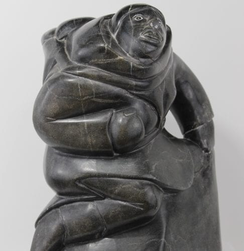 Woman carrying seals Inuit carving