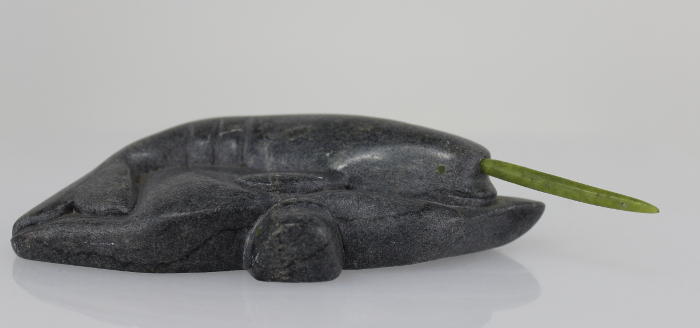 Inuit carving of a narwhale with green tusk