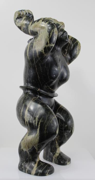 Alaskan Dance, carved in Serpentine by Inuit artist Eliya Pootoogook