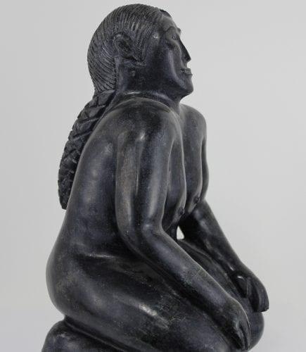 Kneeling nude lady carved by Igloolik artist Joelie Siakuluk