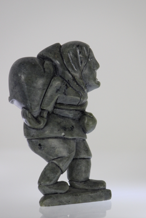 Man carrying seal, carved by Eli Surusila