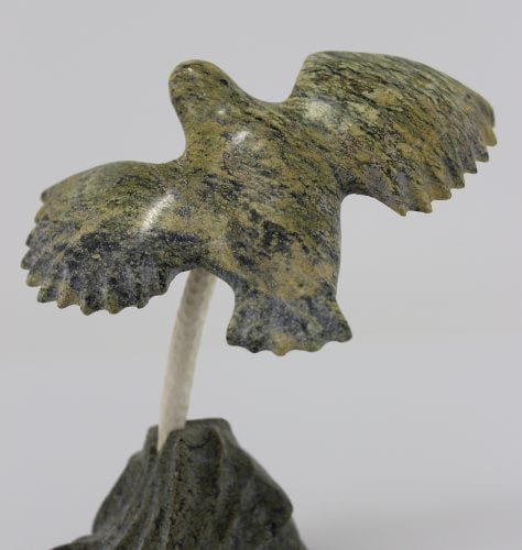 Inuit carving of a bird on nest by Daniel Shimout