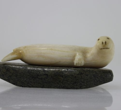 Ivory seal on stone base by unknown Inuit artist