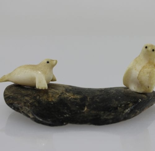 Ivory owl and seal on a stone base by an unknown carver