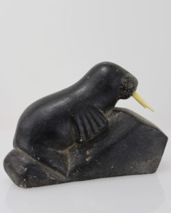 Walrus with ivory tusks by an unknown Inuit artist