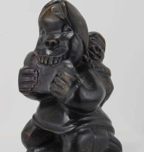 Man eating meat, carved by Johnny Inukpuk, an artist from Inukjuak