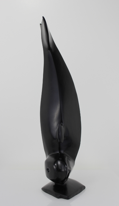 Whale carving with gorgeous lines by Sam Kavik