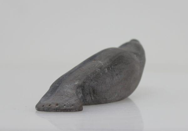Grey seal carved by Sanikiluaq artist Johnassie Uppik.