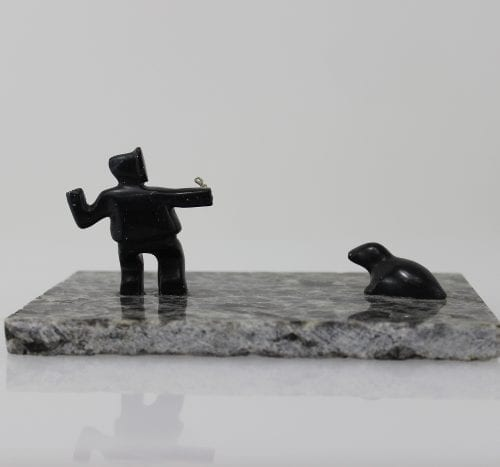 Man and seal on ice, carved by an unknown Inuit artist from Hopedale, Labrador.