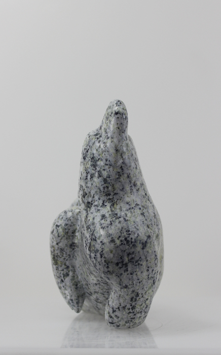 Gorgeous grey bear carved by Itigatata Ragee an artist from Cape Dorset.