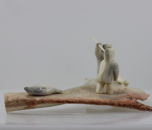 Men and seals is a stunning piece by master carver Emily Illuitok.